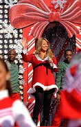 "MERRY CHRISTMAS FROM MC: Grammy Award-winning singer Mariah Carey performs Dec. 3, 2010 at the Magic Kingdom in Lake Buena Vista, Fla., while taping the ""Disney Parks Christmas Day Parade"" TV special. Carey sings two songs -- ""Oh Santa"" and ""All I Want For Christmas is You"" -- in the annual holiday telecast that airs Dec. 25, 2010 on ABC-TV"